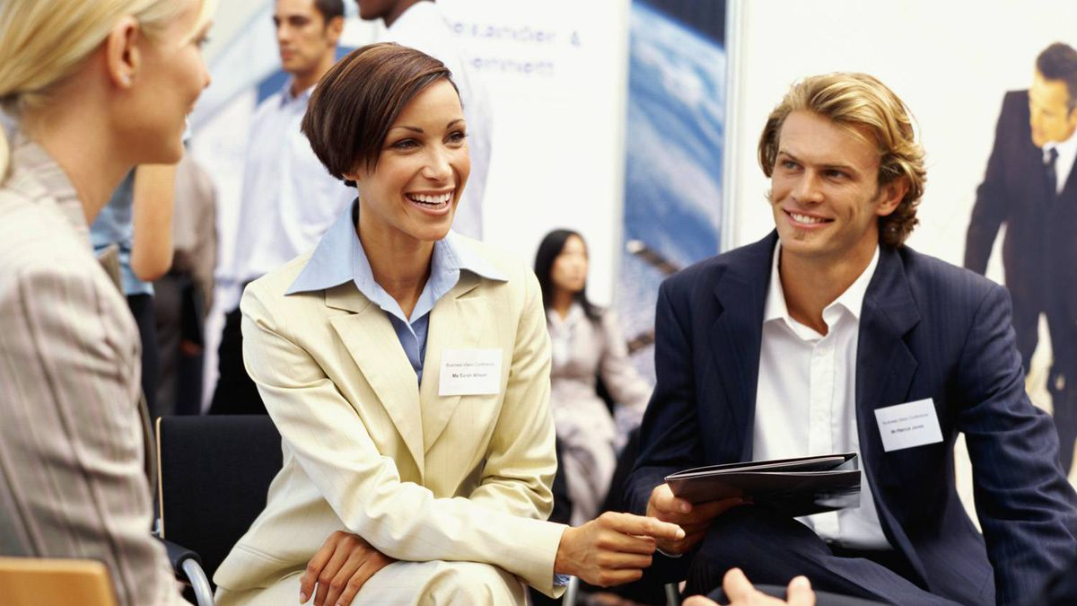 business executives discussing at an exhibition