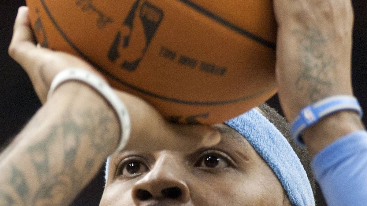 Denver Nuggets forward Carmelo Anthony shoots a foul shot against the New Jersey Nets in the fourth quarter of their NBA basketball game in Newark, New Jersey, January 31, 2011. Anthony has been the centre of numerous trade rumours. REUTERS/Ray Stubblebine