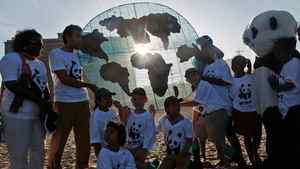 Members of the World Wide Fund converge on a beach in Durban, South Africa, during UN climate-change negotiations on Dec. 7, 2011.