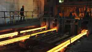A labourer works at a workshop of Maanshan Iron and Steel factory in Hefei, Anhui province March 1, 2012.