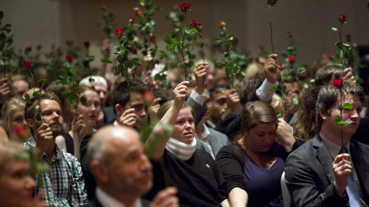 A memorial service to include survivors from the recent shooting at the Utoya island, hold up red roses during the memorial service for the victims of the bomb and shooting massacre, organized by the Norwegian Labour party and its youth organization, AUF, in Oslo, Friday July 29, 2011.