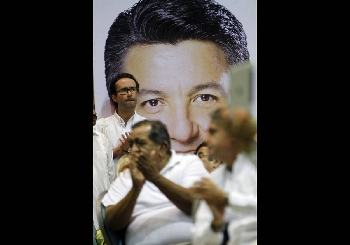 Enrique Pena Nieto's supporters gather in front of a poster of the Mexican presidential candidate during a rally in Ciudad del Carmen, Campeche, Mexico on May 16, 2012. Mr. Pena Nieto is running for the Institutional Revolutionary Party, which hopes to oust the ruling National Action Party.