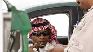 A Saudi man pays after fuelling his vehicle at a gasoline station in Riyadh, Saudi Arabia.