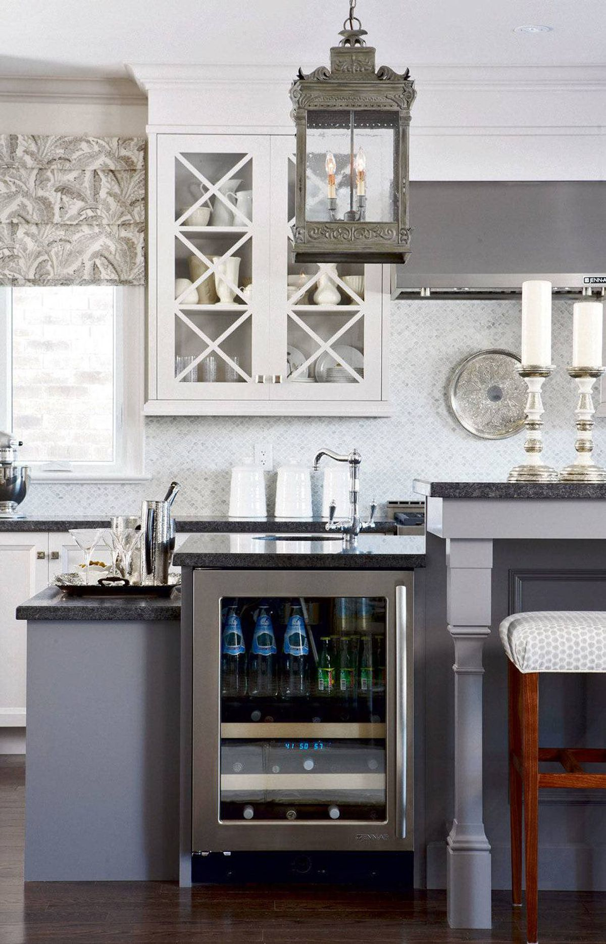 ESCHEW WHITE While white is classic, cheery and bright, it can also be stark and clinical, so why not try a cooler shade? Here, two distinctly smoky greys create a looser, more flexible vibe, easily transforming the kitchen from lunch counter to wine bar depending on the hour of day.