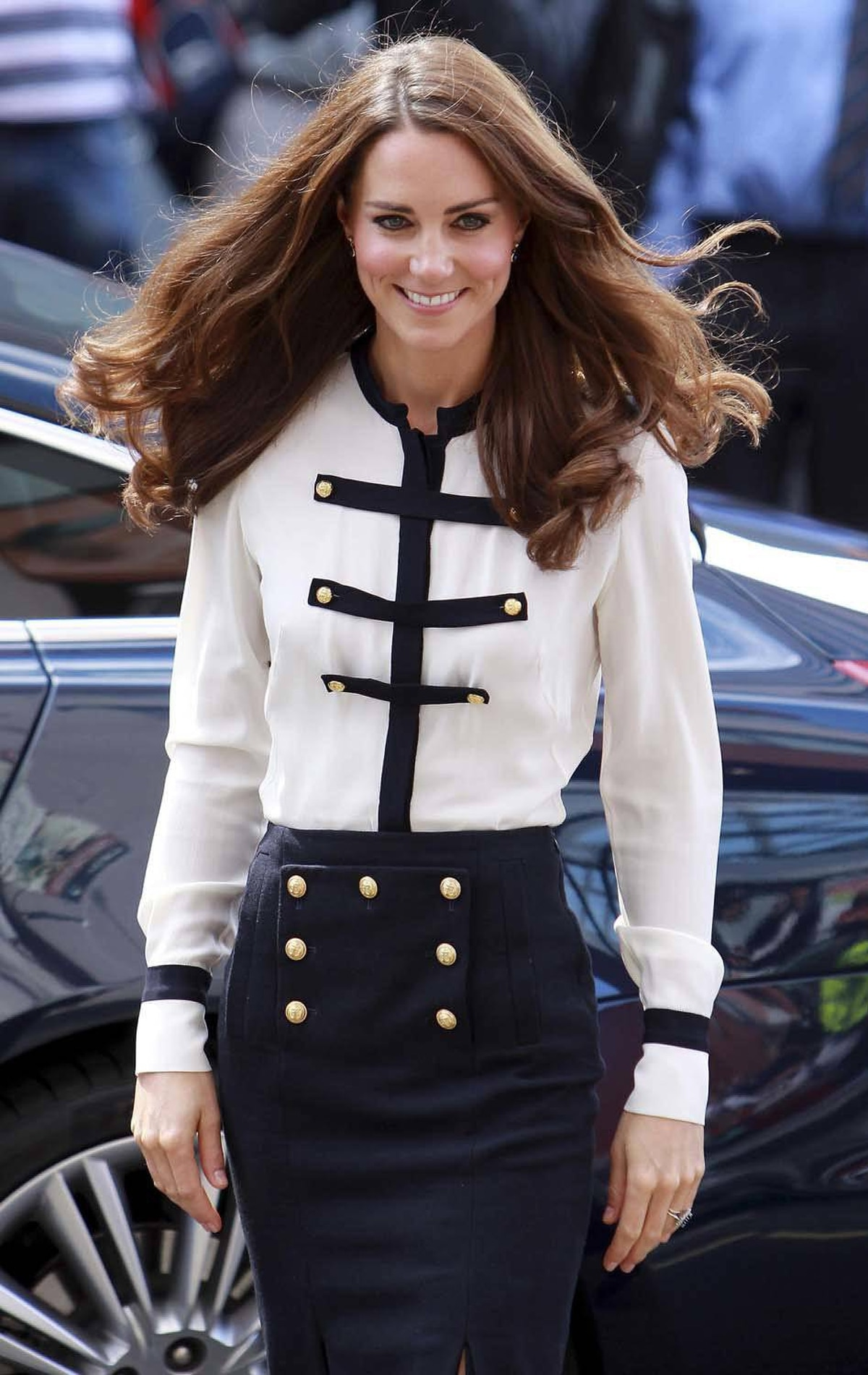 On August 19, Kate visits a part of London damaged by the summer's riots in a military-inspired skirt/shirt combo by Alexander McQueen.