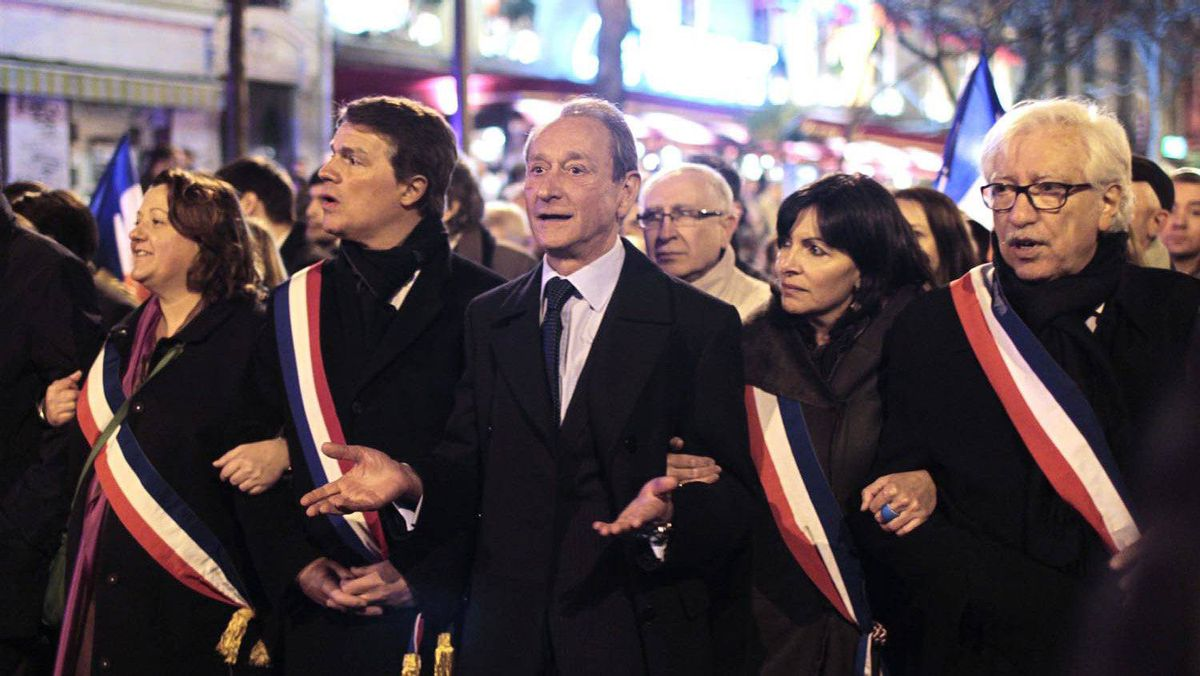 Paris Mayor Bertrand Delanoe, centre, and Deputy Mayor Anne Hidalgo, second right, participate in a mass silent march in Paris to pay tribute to the four victims killed by a gunman at a Jewish school in Toulouse, on March 19, 2012.