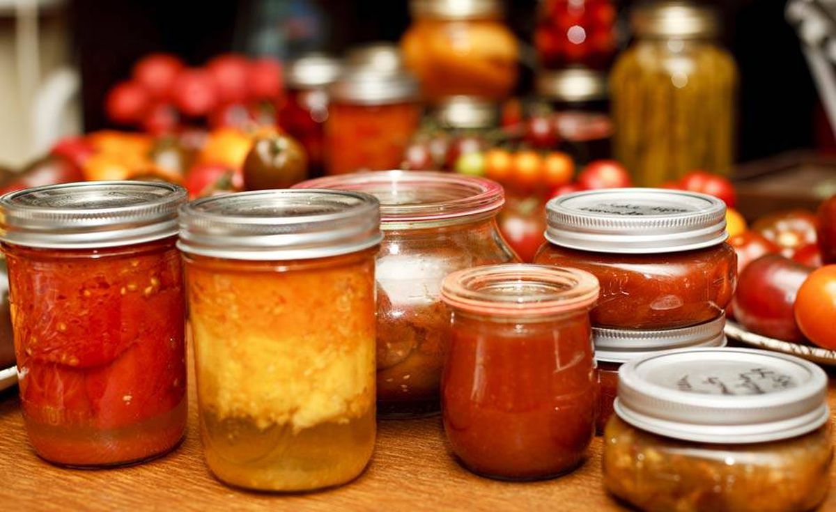 After the jars have been processed in a boiling water bath, Trail removes them from the pot, sets them aside to cool and waits for the popping sound that indicates a successful seal. The result: an array of delicious tomato preserves to see her through the winter.