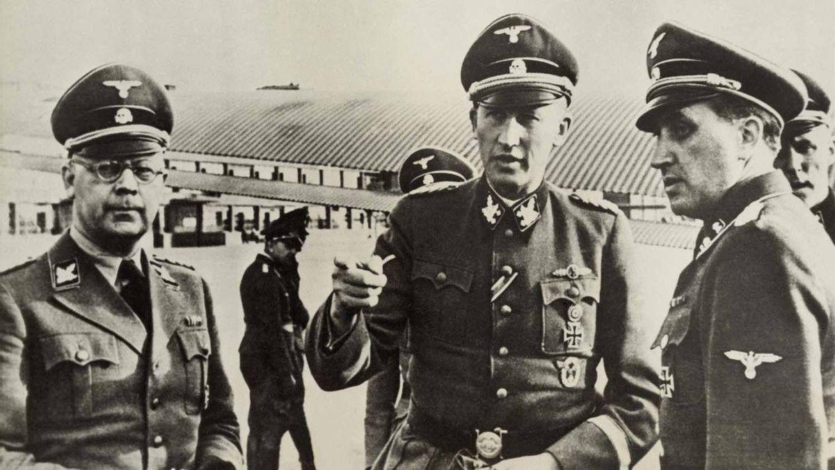 Heindrich Himmler (left) and Heydrich Reinhard (centre), Hitler's architects of the Holocaust, in Paris circa 1940-42