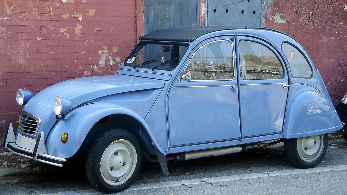 The Citroen 2CV made ingenious use of materials. Many large body panels were curved to optimize stiffness and reduce aerodynamic drag, but the windows used flat glass sheets to lower costs and simplify repairs.