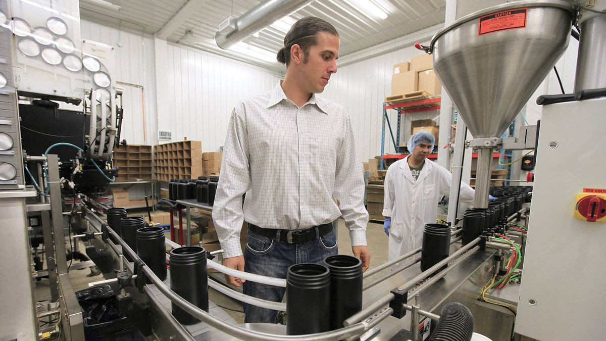 Mike Fata, co-founder of Manitoba Harvest Hemp Foods, inspects part of the production process at the company's Winnipeg facility.