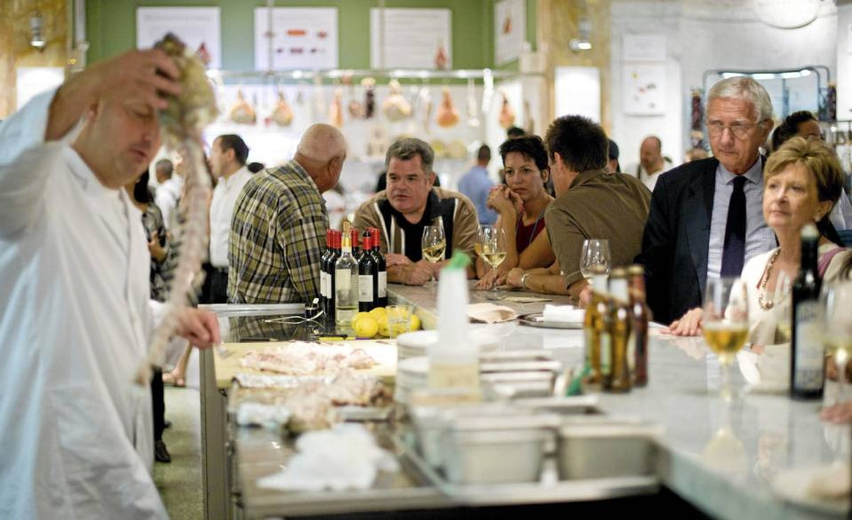 Actor Michael Badalucco, third from left, enjoys a glass of wine at the seafood bar at the opening of Eataly.