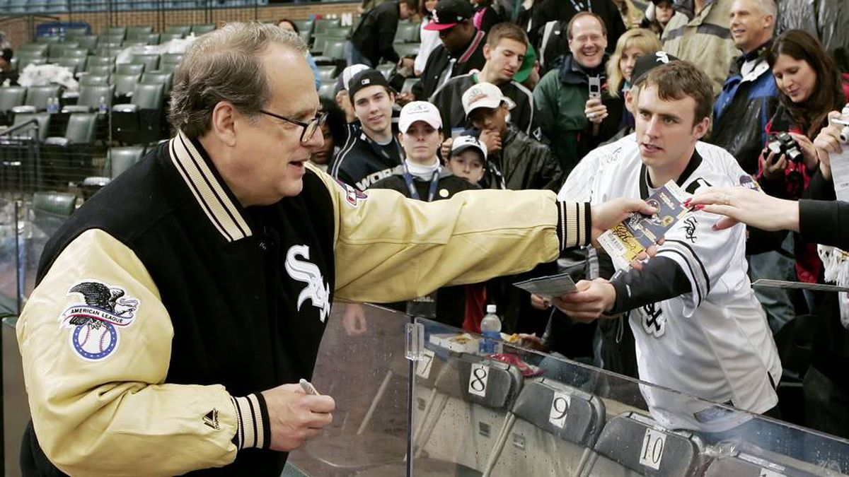 Chicago White Sox owner Jerry Reinsdorf signs autographs for fans before Game 1 of the World Series in Chicago on Oct. 22, 2005.