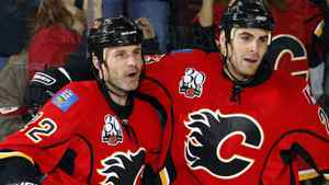 Calgary Flames' Daymond Langkow, left, celebrates his goal with teammate Eric Nystrom during second period NHL hockey action against the Phoenix Coyotes in Calgary, Wednesday, Nov. 25, 2009. Langkow returned to the Calgary lineup on Friday after missing more than a year with a broken neck. THE CANADIAN PRESS/Jeff McIntosh