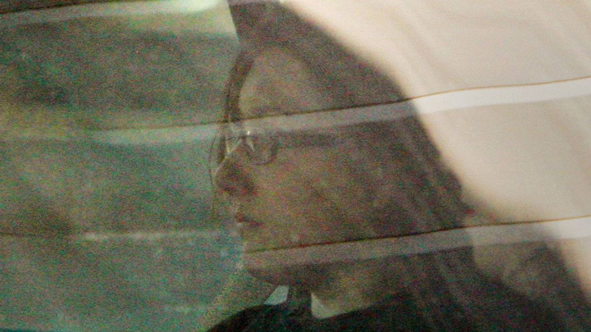 Terri-Lynne McClintic, left, is transported from court for proceedings in the Michael Rafferty murder trial in London, Ontario, Friday, March, 16, 2012.