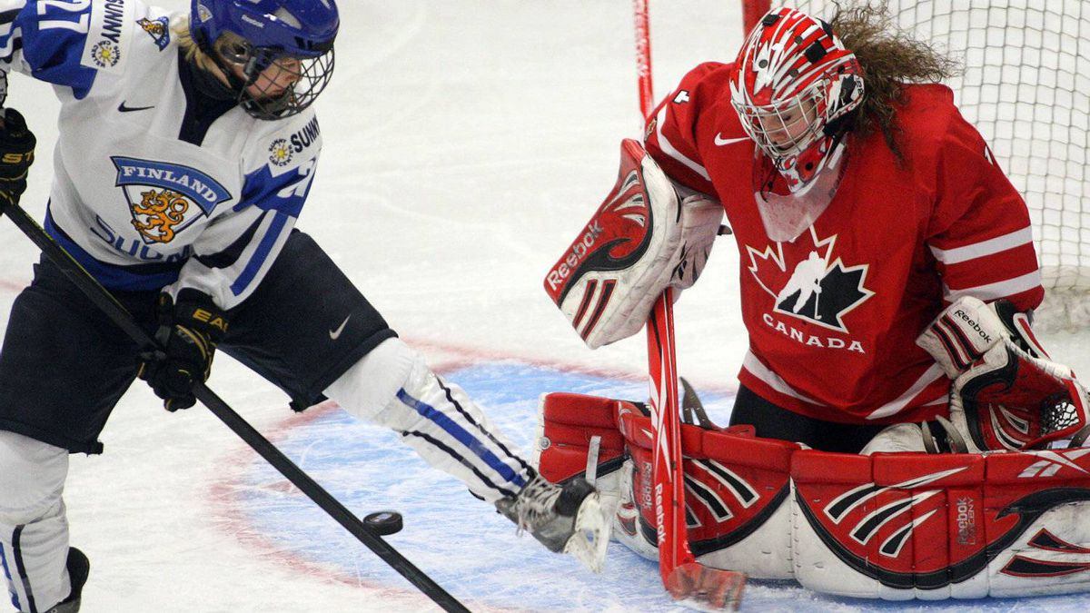 Team Canada's goaltender Shannon Szabados stops Team Finland's Anne Helin during first period action at the World Women's Ice Hockey Championships Sunday. Canada won 3-2.