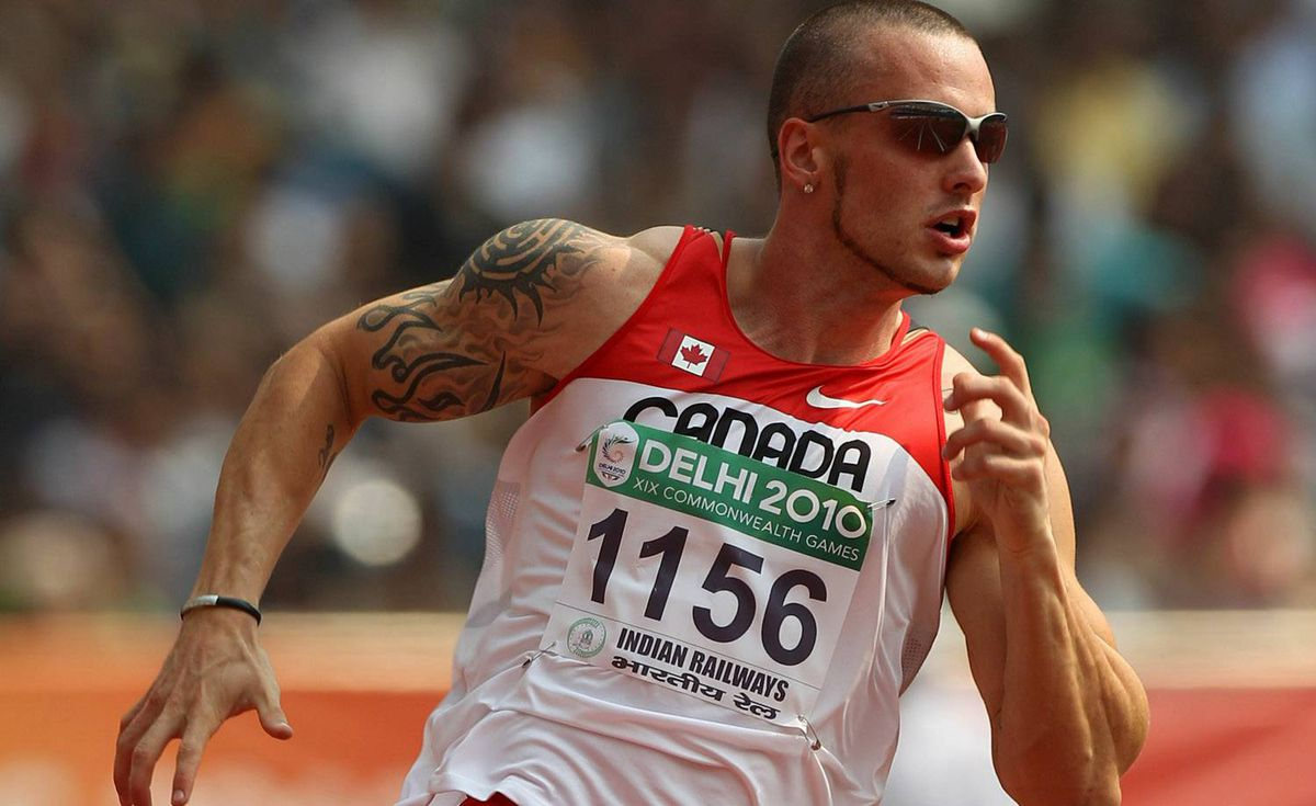 Jared Connaughton of Canada competes in the men's 200 metres first round at Jawaharlal Stadium during day six of the Delhi 2010 Commonwealth Games on October 9, 2010 in Delhi, India. (Photo by Michael Steele/Getty Images)