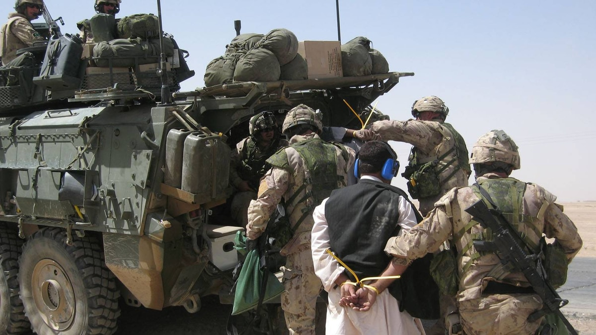 Canadian soldiers escort a detainee in Afghanistan. Les Perreaux/The Globe and Mail