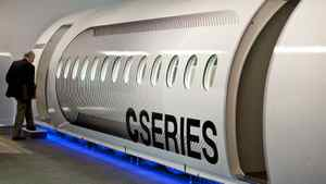 A reporter enters a full-size model of the Bombardier CSeries aircraft as it is introduced Monday, September 14, 2009 in Montreal. Qatar Airways, a potential key customer, has delayed talks with Bombardier about an order of the jets for the time being.