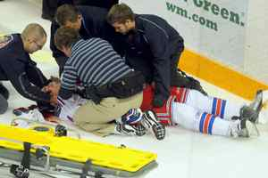 Kitchener Rangers defenceman Ben Fanelli is helped by team trainers and emergency staff after being injured by a hit thrown by Ben Liambas of the Erie Otters on Oct. 30. Liambas has been suspended by the Ontario Hockey League for the remainder of the season.
