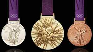 In this image made available by the London Organising Committee of the Olympic Games on Wednesday July 27, 2011 show the London 2012 Olympic medals designed by British artist David Watkins. (AP Photo/LOCOG, HO)
