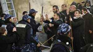 Palestinian police officers intervene in a fight between Greek Orthodox and Armenian clergymen during the cleaning of the Church of the Nativity in Bethlehem on Dec. 28, 2011.