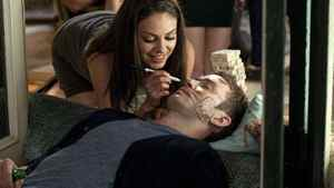 Mila Kunis plays a prank on Justin Timberlake in a scene from Friends With Benefits.