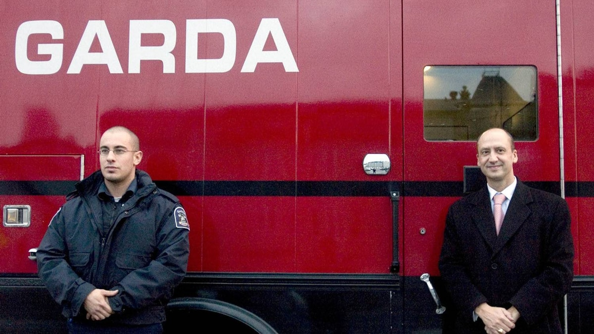 Garda CEO Stéphan Crétier (right) stands with a security officer next to a company truck in this file photo.