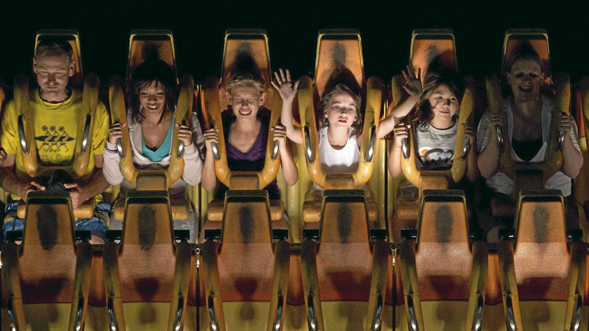 Fair goers ride Hell's Gate at the Pacific National Exhibition in Vancouver, Aug. 20, 2011.