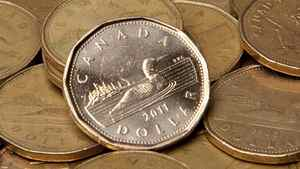 Canadian dollars (loonies) are pictured in Vancouver, B.C. Thursday, Sept. 22, 2011.