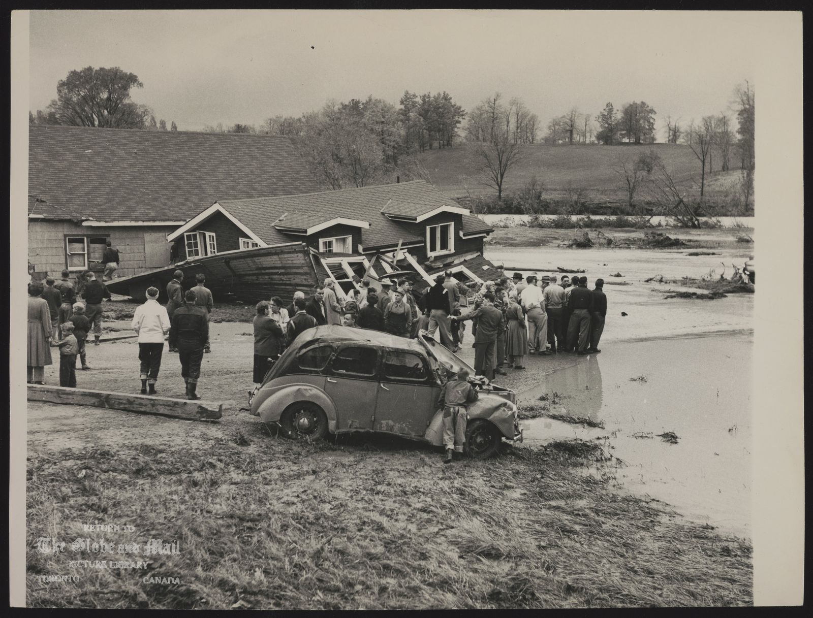 HURRICANE HAZEL Weston. Fairglen Rd. homes jammed together by flood. [Hurricane Hazel hits Weston, Ontario on October 16, 1954. Death and destruction rode the crest of Ontario flood waters in the nightmare hours of Saturday morning, leaving 54 known dead, 69 missing and presumed drowned, and a chaotic condition never before experienced in Southern Ontario.]