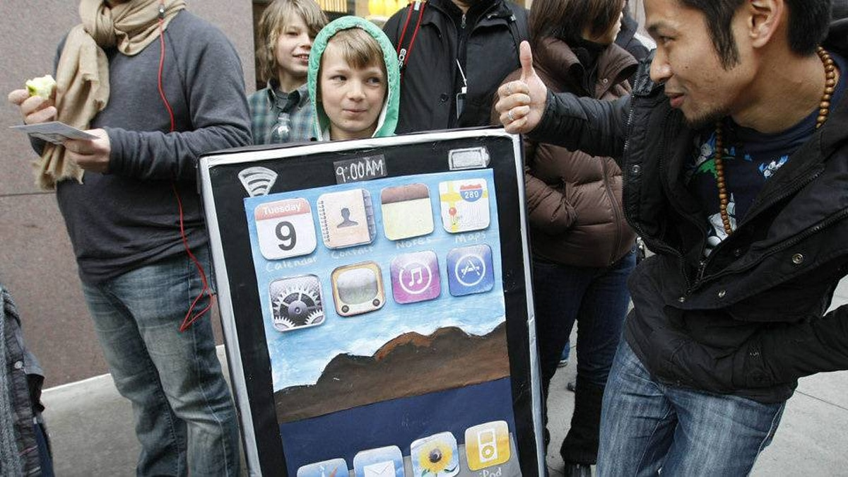 Lyle Kahmey, 9, wears an iPad billboard that he and his mother painted, as he waits in line to buy an iPad on the first day of Apple iPad sales at an Apple Store in San Francisco, Saturday, April 3, 2010
