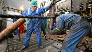 Workers on a Precision Drilling Corp. oil rig tap into North Dakota's Bakken formation.