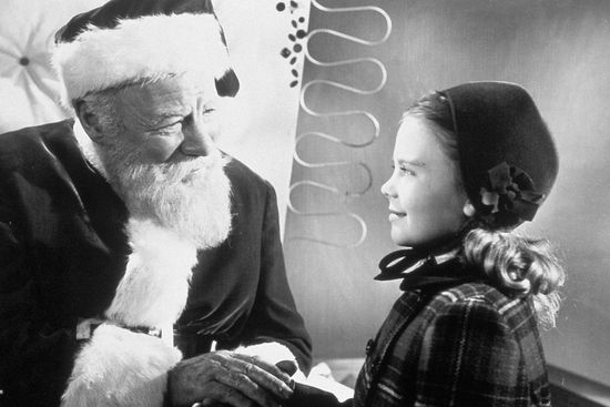 "Actor Edmund Gwenn as Kris Kringle greets actress Natalie Wood in a scene from the 1947 film ""Miracle on 34th Street,"" in this undated promotional photo."