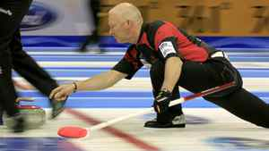 Canada skip Glenn Howard delivers his stone during play against France at the World Men's Curling Championship 2012 in Basel March 31, 2012.