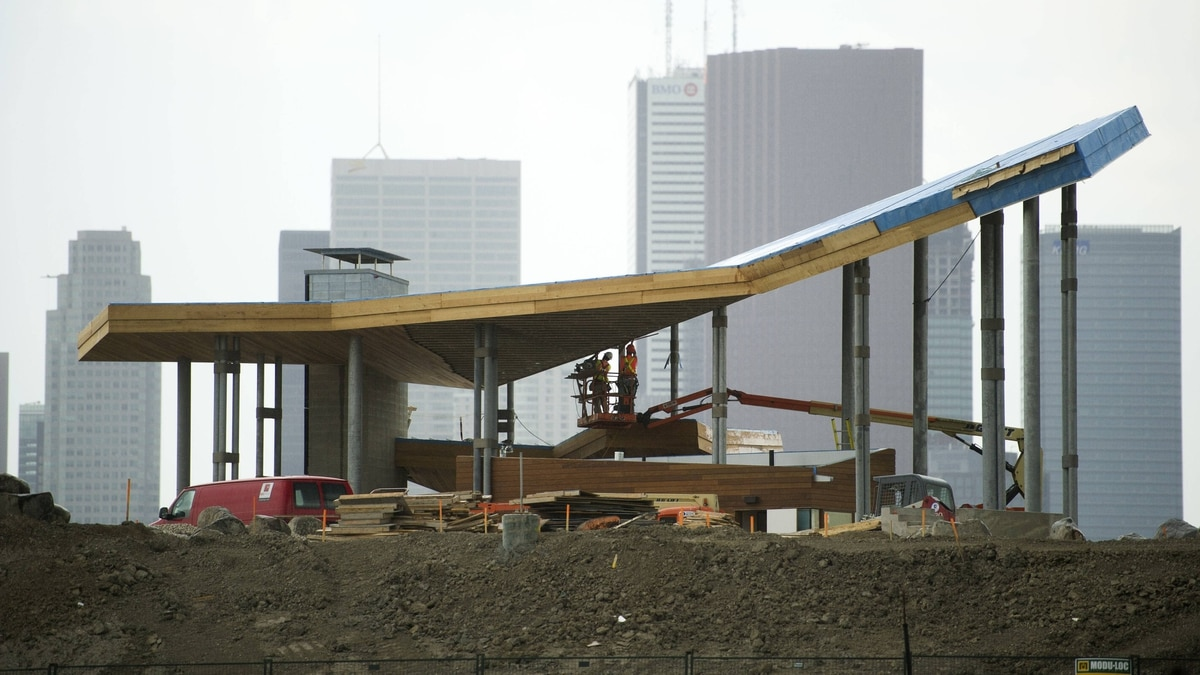 Work crews work on construction of the West Don Lands in Toronto, Ont. June 26, 2011. The area is being transformed from industrial lands into a mixed-use residential community located next to the Don River.