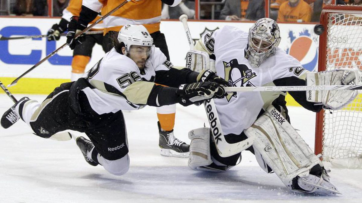 Pittsburgh Penguins' Kris Letang (58) and Marc-Andre Fleury (29) cannot stop a goal by Philadelphia Flyers' Jakub Voracek, of the Czech Republic, in the first period of Game 4 in a first-round NHL Stanley Cup playoffs hockey series on Wednesday.