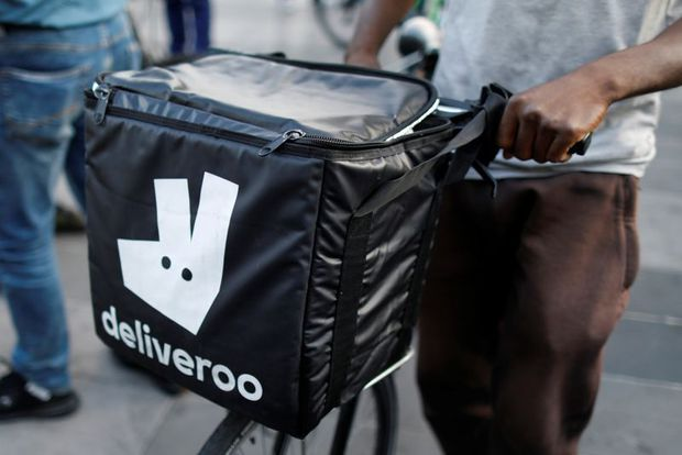 United Kingdom watchdog escalates probe of Amazon's Deliveroo deal