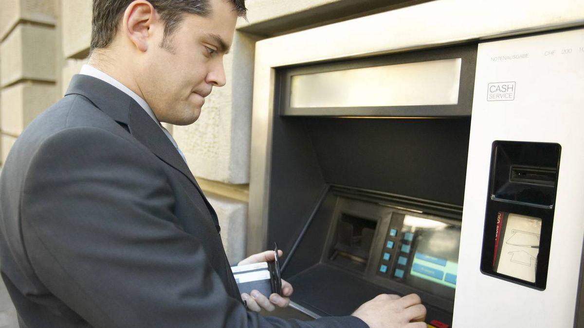Man at ATM machine