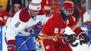Calgary Flames' Al MacInnis, right, and Montreal Canadiens' Russ Courtnall battle for the puck during the NHL Heritage Classic alumni game in Calgary, Alta., Saturday, Feb. 19, 2011. The Calgary Flames will play the Montreal Canadiens on Feb. 20 in the second NHL outdoor game of the 2010/2011 season. THE CANADIAN PRESS/Jeff McIntosh