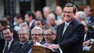 Minister of Finance Jim Flaherty smiles as he delivers the federal budget in the House of Commons on Parliament Hill in Ottawa on Thursday, March 29, 2012.