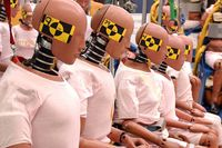 General Motors crash test dummies sit on display at the GM Proving Grounds in Milford, Michigan prior to the 15,000th crash test conducted by GM Wednesday, September 22, 2004.