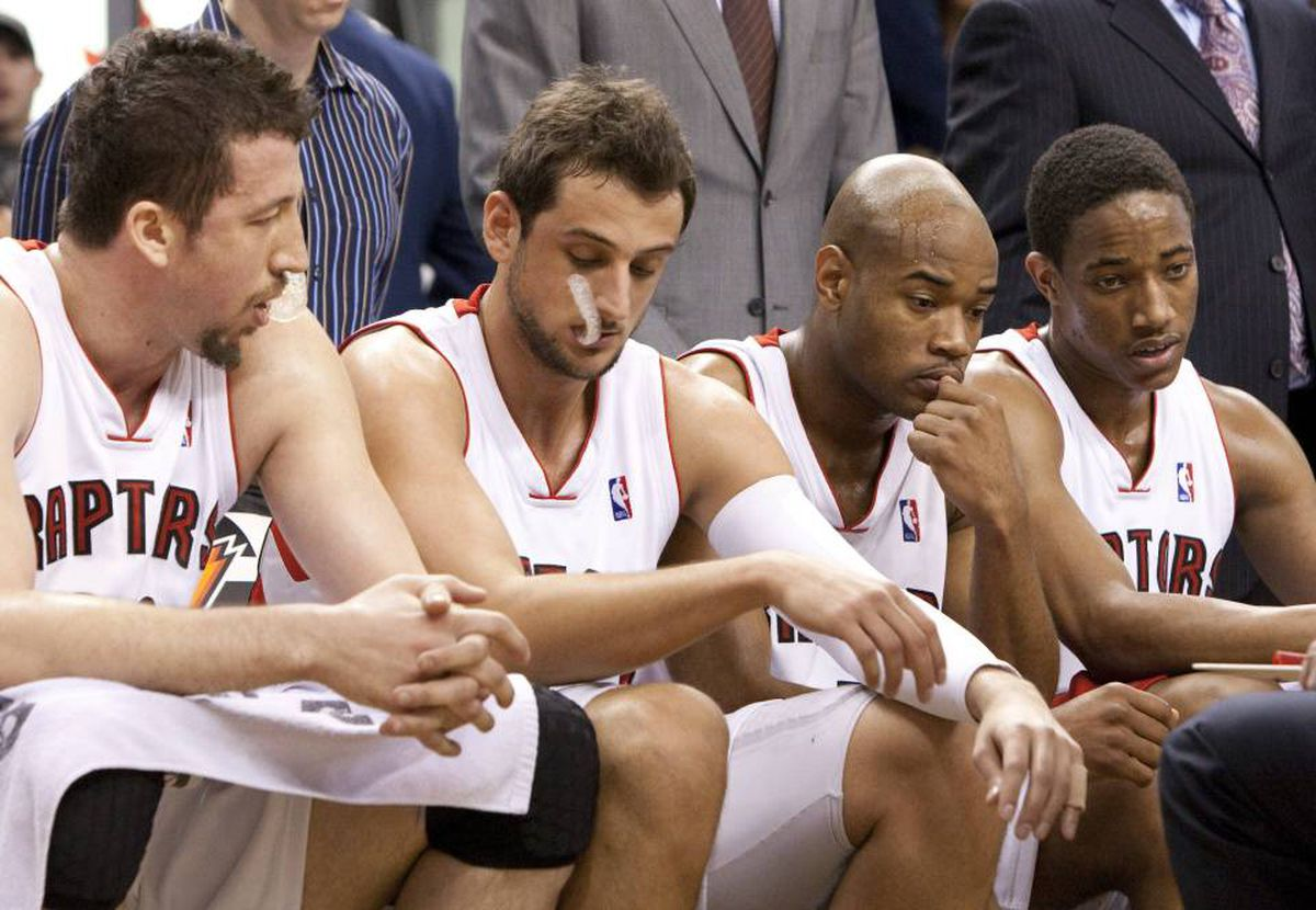 Toronto Raptors' Hedo Turkoglu (left to right), Marco Belinelli, Jarret Jack and DeMar DeRozan sit on the bench during second half NBA action against the New York Knicks in Toronto on Wednesday April 14, 2010.