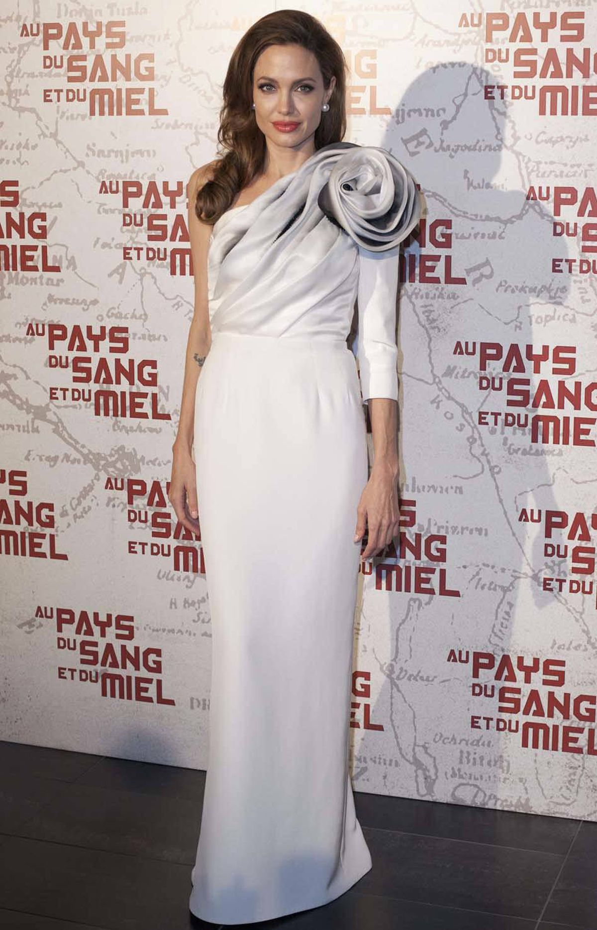 "Angelina Jolie has her scalp tension set to ""moderate"" at the Paris premiere of ""In The Land of Blood and Honey"" last week."