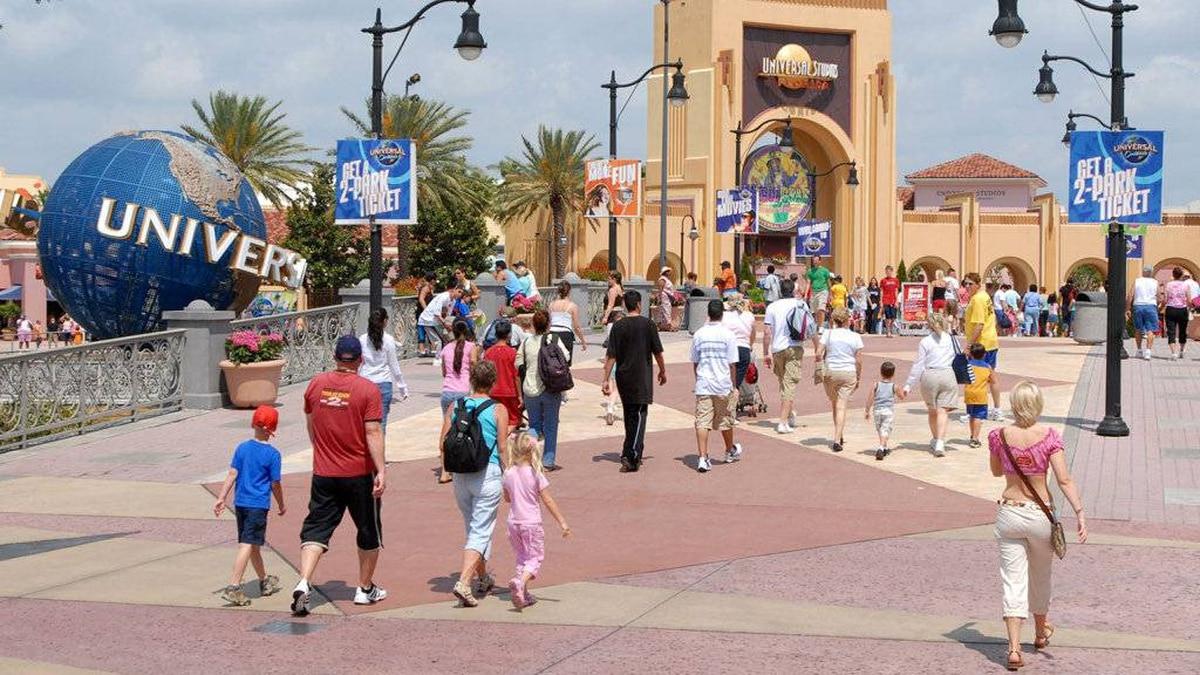 Visitors head toward the entrance of the Universal Studios Florida theme park in Orlando, Fla., April 22, 2006.