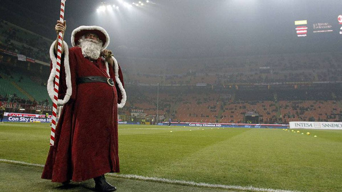 Santa stands on the field before the start of the Italian Serie A soccer match between AC Milan and Chievo at the San Siro stadium in Milan.