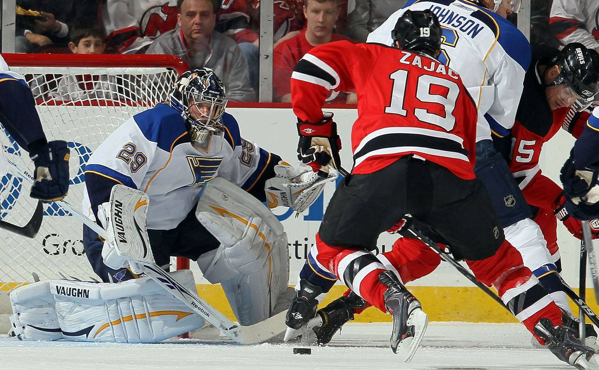 Ty Conklin #29 of the St. Louis Blues makes a save against Travis Zajac #19 of the New Jersey Devils at the Prudential Center on March 20, 2010 in Newark, New Jersey. (Photo by Jim McIsaac/Getty Images)