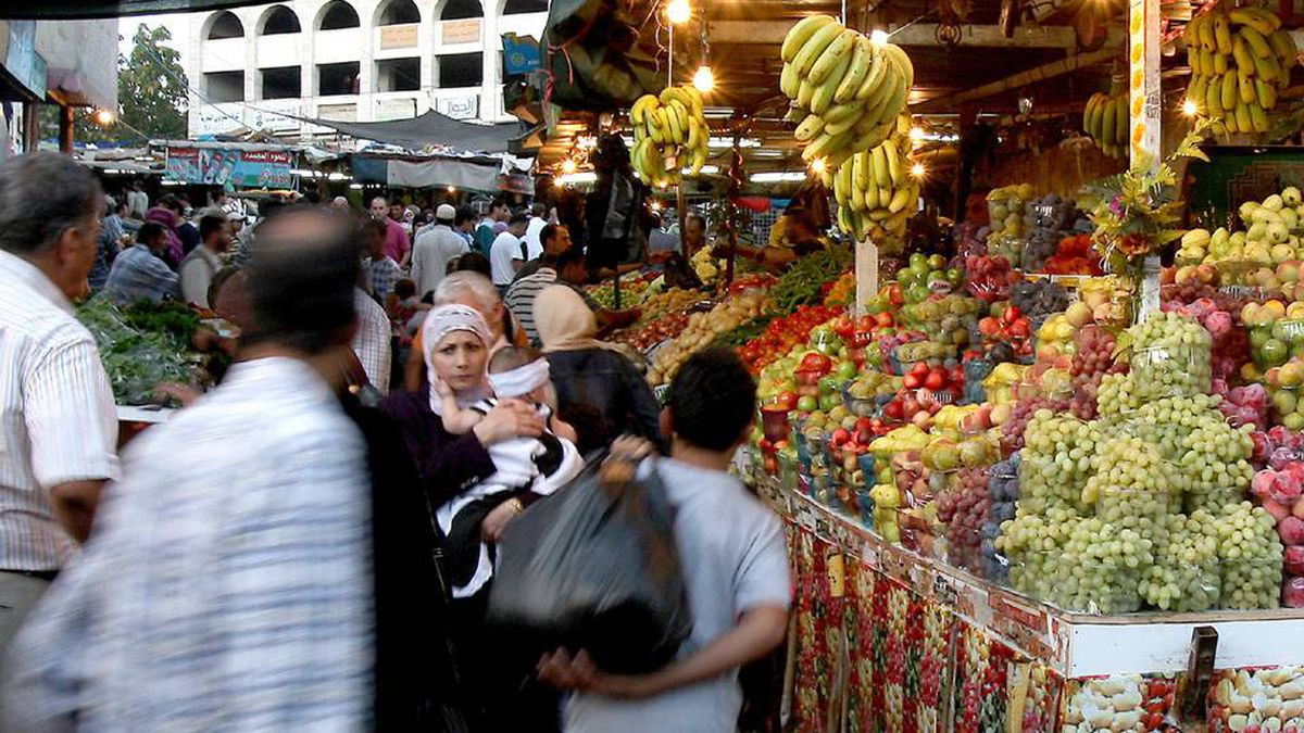 Palestinians shop at a market ahead of the start of the Muslim holy fasting month of Ramadan in the West Bank city of Ramallah.