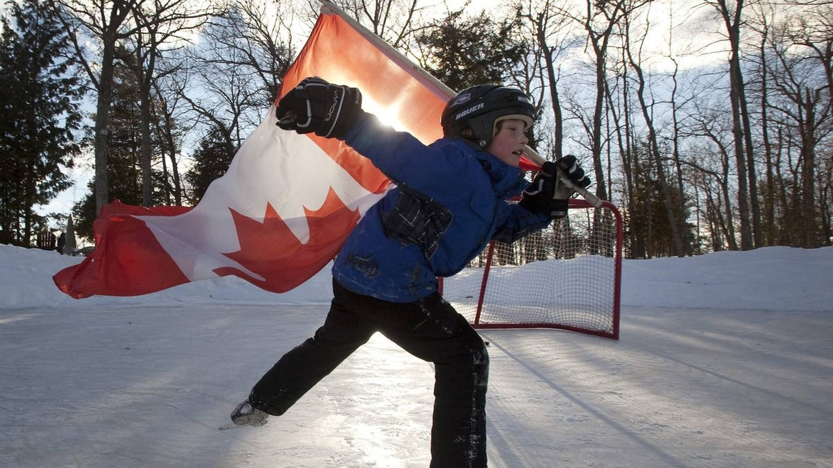 Jacob Sanderson, 9, celebrates Hockey Day in Canada on a pond rink near Bobcaygeon Ontario on Pigeon Lake, Saturday February 12, 2011. The annual event celebrates the roots and spirit of Canadian hockey across Canada. THE CANADIAN PRESS/Fred Thornhill