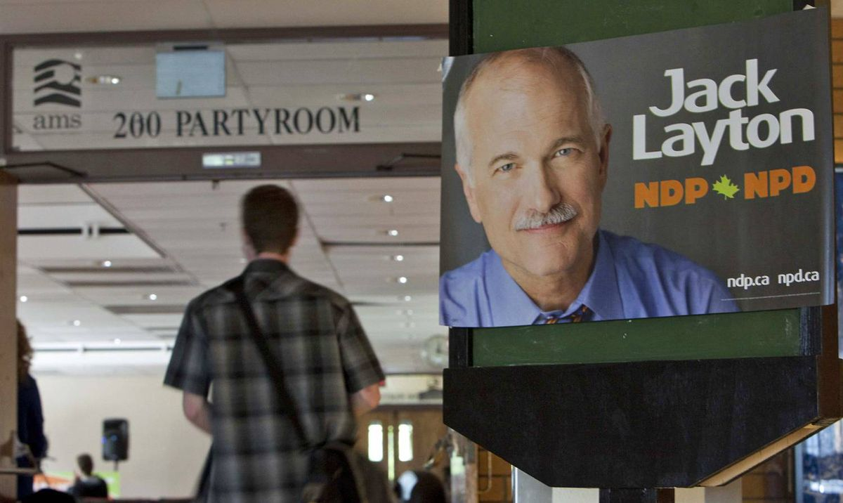 A student arrives to attend a question and answer session with Jack Layton in the party room of the UBC student union building.