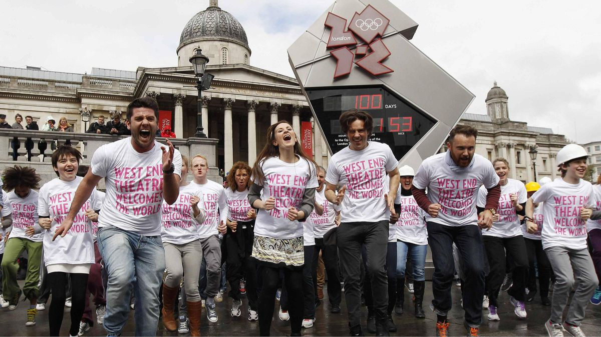 """Members of West End theatre shows and British athletes take part in a """"West End Warm-Up"""" performance at Trafalgar Square in London April 18, 2012."""